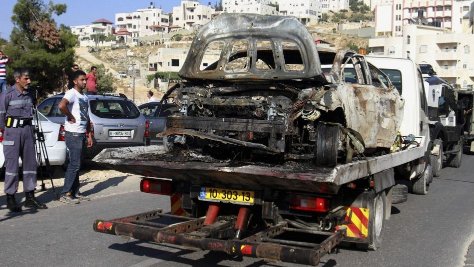 A stolen Israeli vehicle burnt and abandoned in Hebron