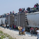 "Central American migrants aboard ""La Bestia"" moving north through Mexico and aiming for the US."