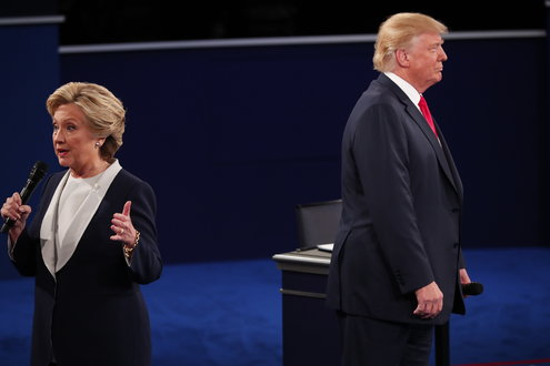 """Donald Trump, not wanting to """"run away"""" from his own podium, nor be accused of intimidating Hillary, decides to face away from her."""